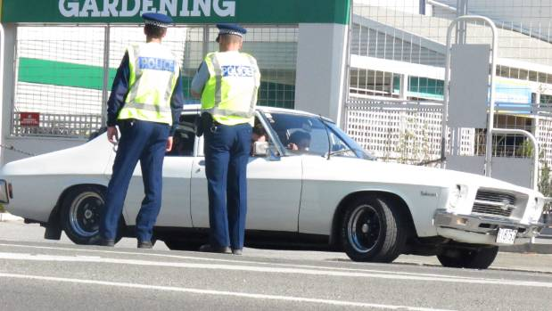 Police talk to a car filled with Alexandra Blossom Festival goers in 2010.