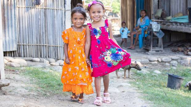 To get to school Nevia Magno (right), 4, walks through the house of her friend Febiana Canizio, 4. Here they walk the ...