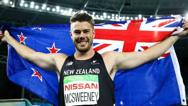 Rory McSweeney shows his delight and Kiwi pride after winning the bronze medal in the men's javelin F4.