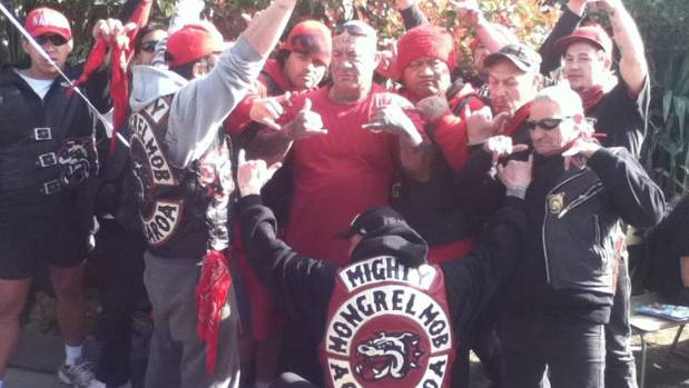 The former president of the Mongrel Mob's Aotearoa chapter, Joseph 'Junior' Wiringi, surrounded by other members of the gang.