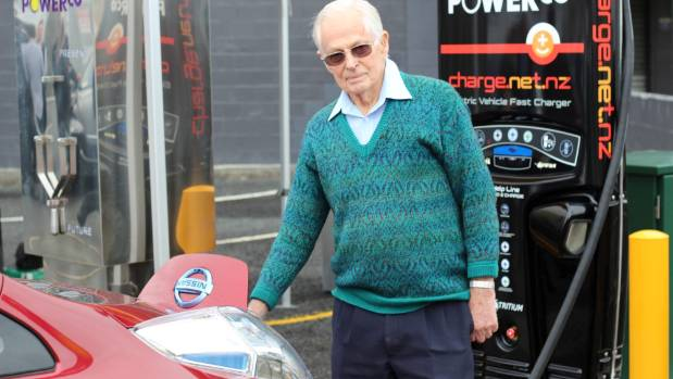 Thames man Roald Barthow charges his car using the new electric vehicle charger at the Thames District Library car park.