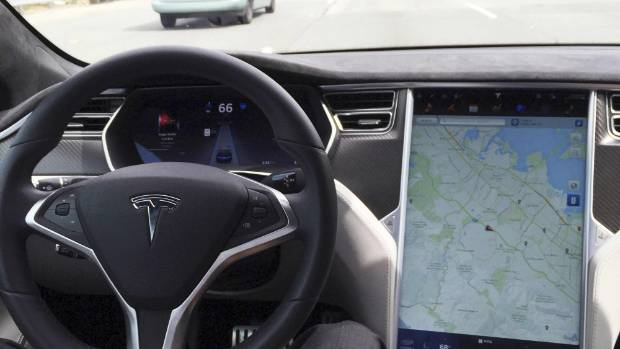 The interior of a Tesla Model S is shown in autopilot mode in San Francisco, California, U.S., April 7, 2016.   ...