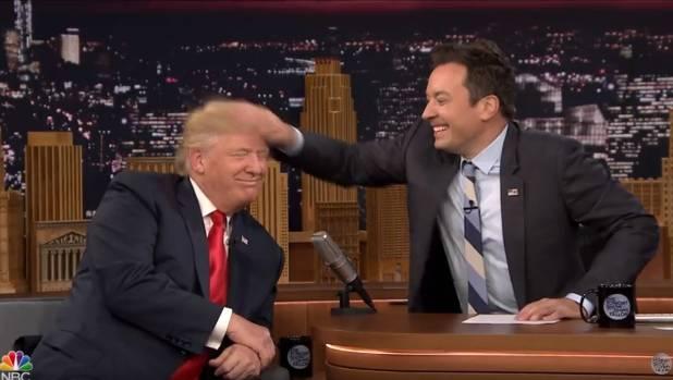 'Tonight' host Jimmy Fallon musses Republican Presidential hopeful Donald Trump's hair.
