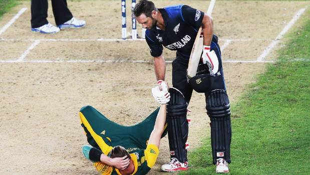 Grant Elliott helps Dale Steyn up after winning the 2015 Cricket World Cup semifinal match between New Zealand and South ...
