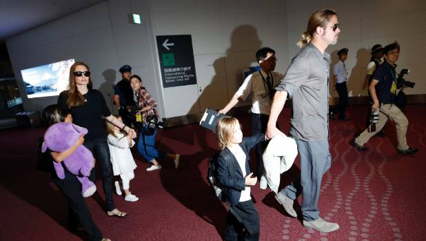 Brad Pitt and actress Angelina Jolie arrive with their children Knox, Vivienne and Pax at Haneda international airport ...