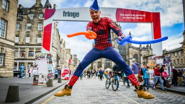 Street performance at Edinburgh Fringe Festival on the Royal Mile, Edinburgh.