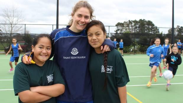 Angel Temu and Sarah Manu of Glen Innes School with Saint Kentigern College student netball coach Hannah Ward.