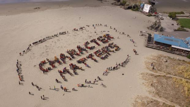 About 1000 Christchurch school children lined Sumner Beach to spell 'Character Matters' for the 2016 Global Character ...