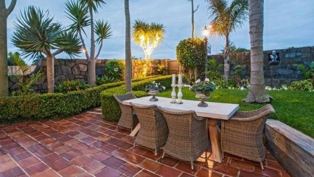 This tropical paradise in Westmere will make you feeling like it's summer all year round.