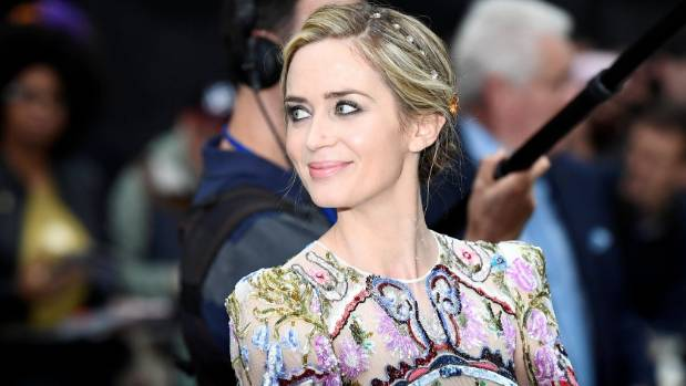 Emily Blunt poses as she arrives at the World premiere of The Girl on the Train at Leicester Square in London.