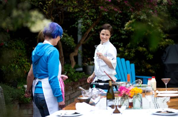 Crystal Hilton waits for direction from Helen Flitcroft as they prepare to make chocolate mousse.