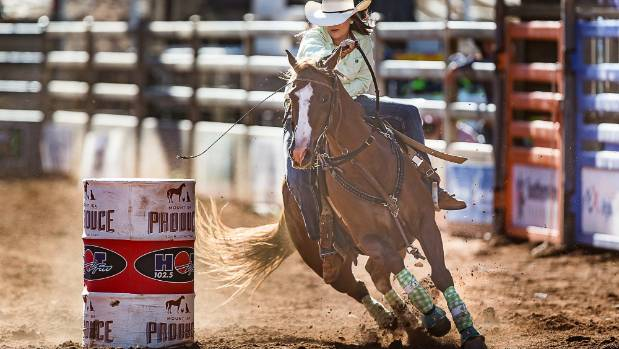 Jaimi Dowling in action in the Ladies Barrel Racing category at the Mount Isa Mines Rotary Rodeo, in Queensland.
