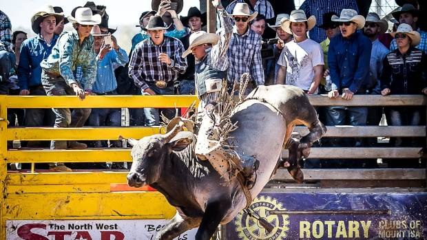 The winner of the Open Bull Ride category of the Mount Isa Mines Rotary Rode, Jared Burgher, holds on tight.