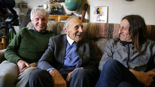 Norman Dickie, 100, with his two sons Ross, left, and Grant.
