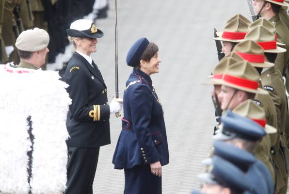 Dame Patsy Reddy greets military personnel at parliament.