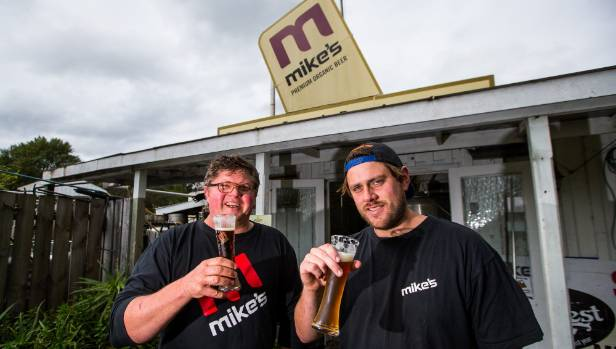 Owner Ron Trigg and head brewer Jesse Sigurdsson share a beer as Mike's Brewery takes back over from liquidators who ...