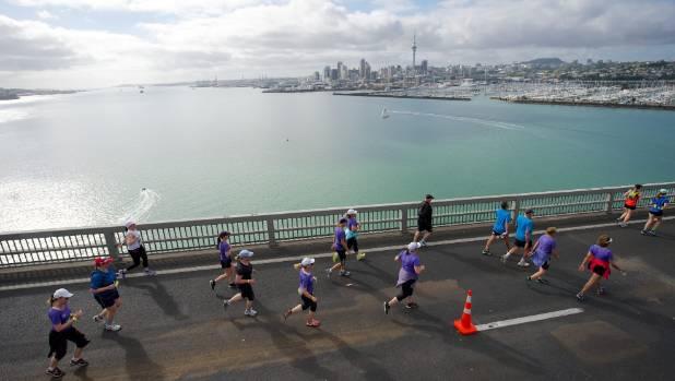 Auckland Marathon participants crossing the Harbour Bridge.