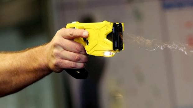 A policewoman firing a Taser at an angry man for a third time, while he lay on the ground in Christchurch, amounted to ...
