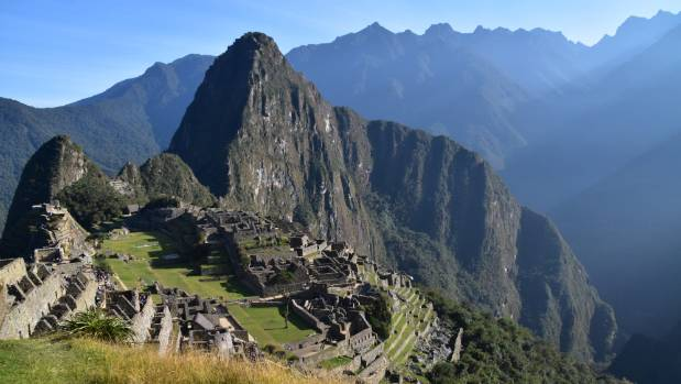 The sun has just risen over Machu Picchu as we make our descent from the Sun Gate to the ruins.
