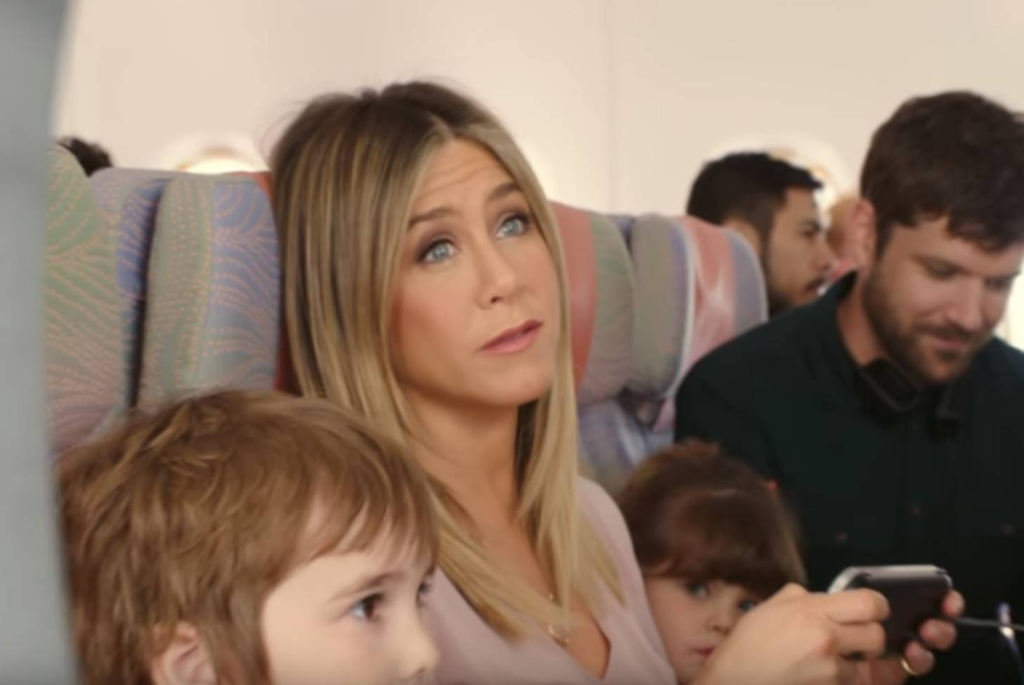 Watch Jennifer Aniston Takes A Turn In Economy Class In New
