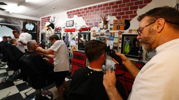 Shawn Stormann cuts the hair of Joel Felber at Stormy's Man Cave in the City Centre Arcade.