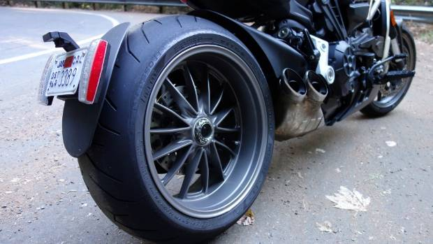 Wide 240mm rear tyre can push the front wide when powering out of tight corners.