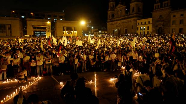 Supporters light candles in Bolivar Square.