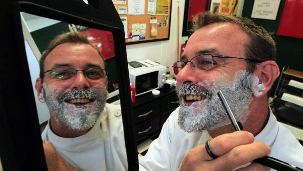 Nelson barber Shawn Stormann checks himself in the mirror for a blade shave in  2012 at his then new premises Stormy's ...