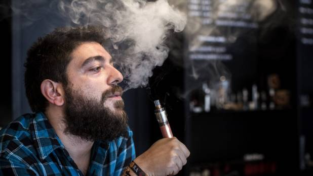 London-based Vape Lab employee Leonardo Verzaro uses an e-cigarette while working. The British Department of Health ...