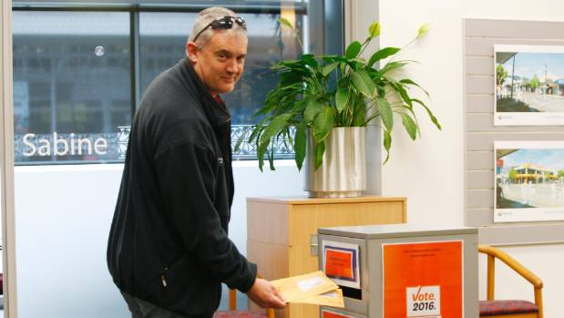 Richmond resident Nigel Brabyn posts voting papers in the ballot box at the Tasman District Council office.