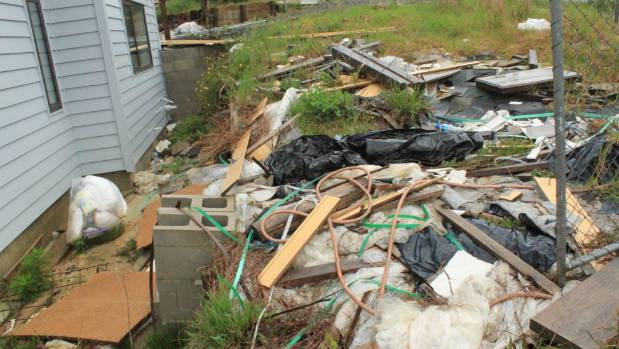The property is unfinished and filled with rubbish.
