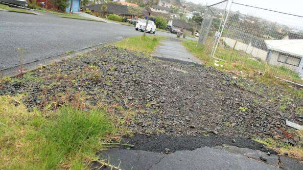 Residents say the accessways that were cut through the footpath have rendered it unsafe.