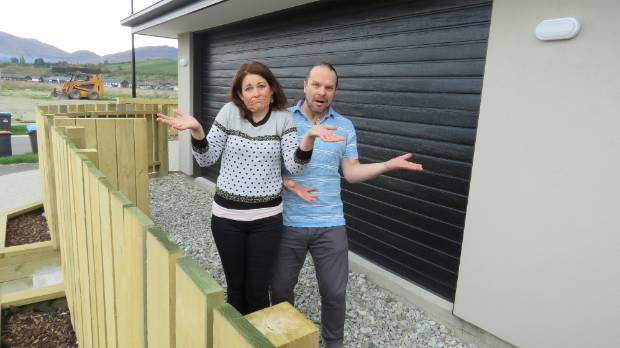 Shotover Country residents Beck Cole and Deo Bohn were initially ''disappointed'' by the fence.