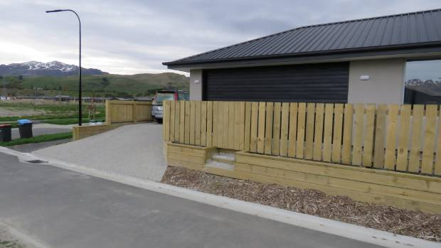 The fence blocks access to a garage in Shotover Country.