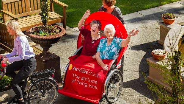 Molly Craig and Bessie Bromell take a ride around Park Lane, pedalled by Dorthe Pedersen, founder of Cycling Without Age.