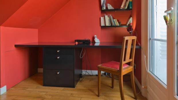 Even a small nook can be repurposed as an at-home workspace; and experts say the colour red may enhance your ...