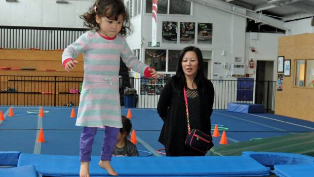 Sovann Stewart, 3, tries out the trampoline at Hutt Valley GymSports.