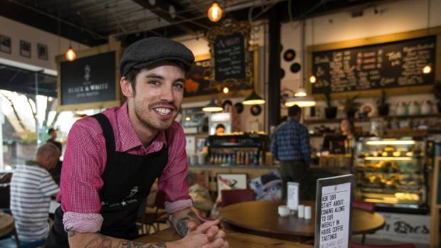 Bink Bowler, owner of Victoria St's Black & White cafe, is among those thriving in Christchurch's congested coffee market.
