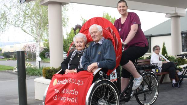 May Harris, left, and Vern Neal, piloted by Ashwood Park diversional therapist Ange Stanton.