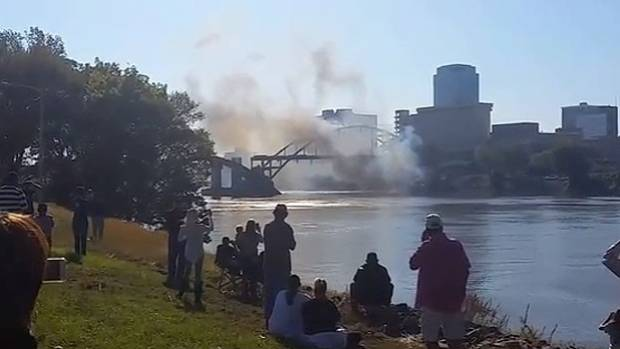 Controlled explosions to demolish the bridge happened on cue, but when the smoke cleared, its steel arch and deck stood ...