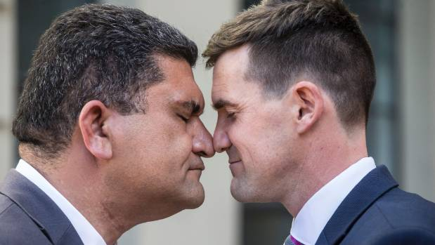 Wellington's new Deputy Mayor Paul Eagle and Mayor Justin Lester share a hongi outside the city council building.