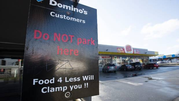 Warning signs are up outside Food 4 Less in Otahuhu.