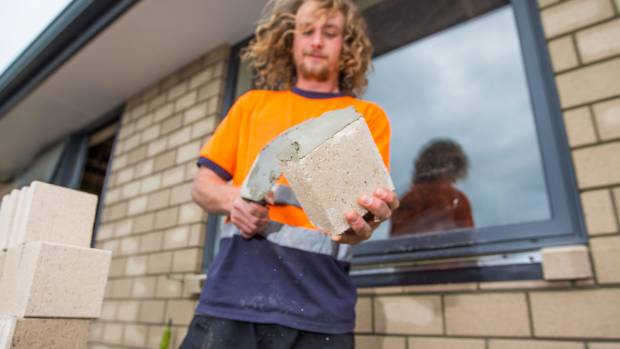 Taranaki brick-layer Elijah Webby gets stuck into his task at the Taranaki Retreat.