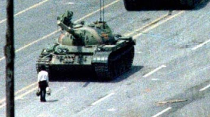 The iconic photo of a Chinese citizen facing off with a tank with nothing but two bags of groceries in Tiananmen Square.