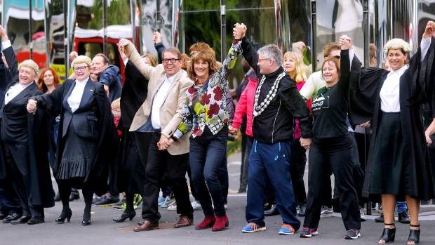 Council/government workers, politicians, QC's, and emergency services turned out to dance Poi E as part of the Taranaki ...