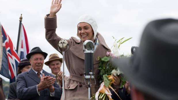 Jean Batten (Kate Elliott) waves to the crowd in the one-off Kiwi drama Jean.