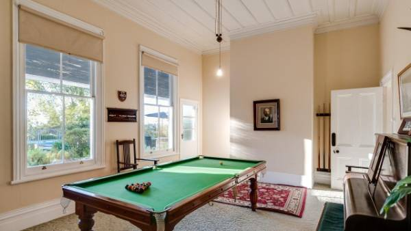 The billiards room is reminiscent of a bygone era.