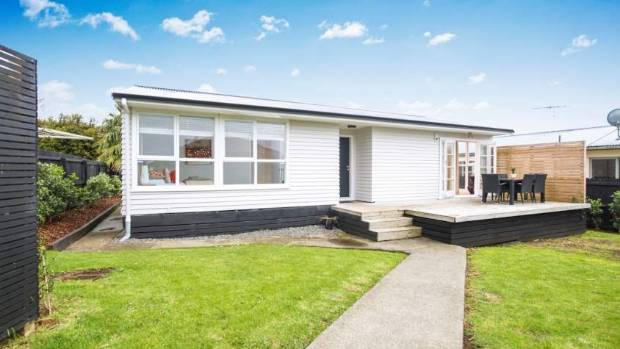 6 Hikurangi St, Te Atatu Peninsula​ is securely set back from a quiet street.