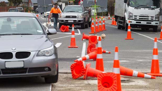 Roads cones scattered over the road, blocking traffic on Christchurch's Wairakei Rd.