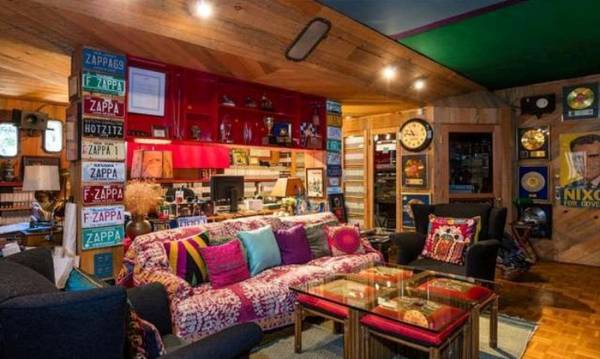 Music and cultural memorabilia from the 60s and 70s decorated the basement den.